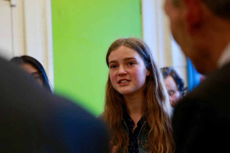 A young person asks a question to assembly members in Cwmbran Centre for Young People