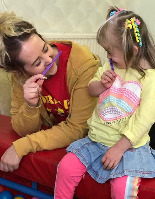 A child and playworker at one of the Torfaen Easter playschemes