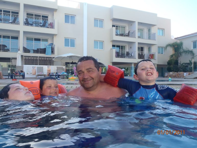 Jerry in a pool with three of his grandsons